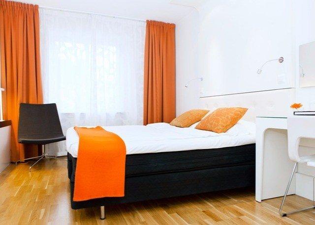 orange property Suite living room Bedroom