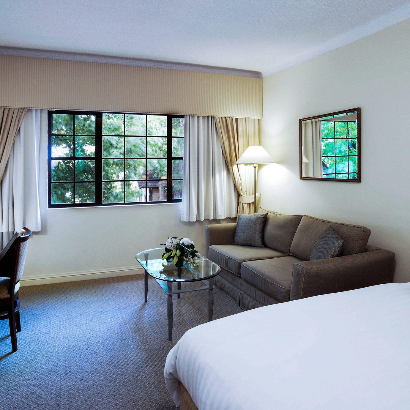 sofa property living room home Suite condominium cottage Villa Bedroom flat containing