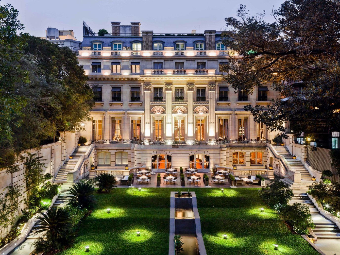 Boutique Hotels Luxury Travel tree outdoor mansion estate building stately home City real estate plaza Villa mixed use home plant national trust for places of historic interest or natural beauty facade palace historic house house apartment building Resort