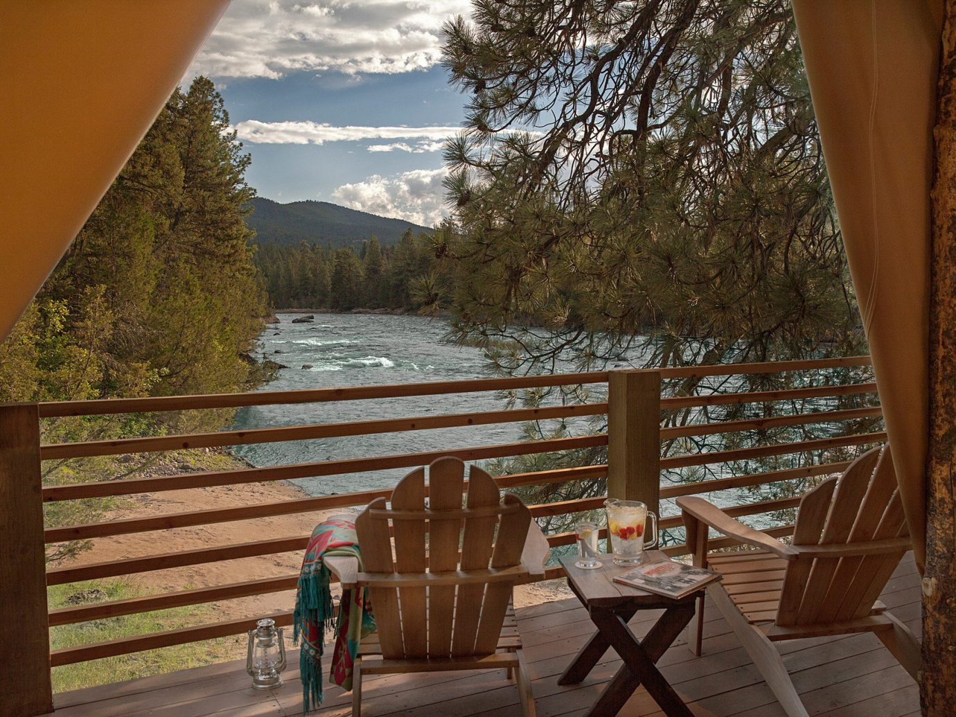 Glamping Outdoors + Adventure Weekend Getaways tree outdoor chair house vacation estate wooden home cottage area overlooking