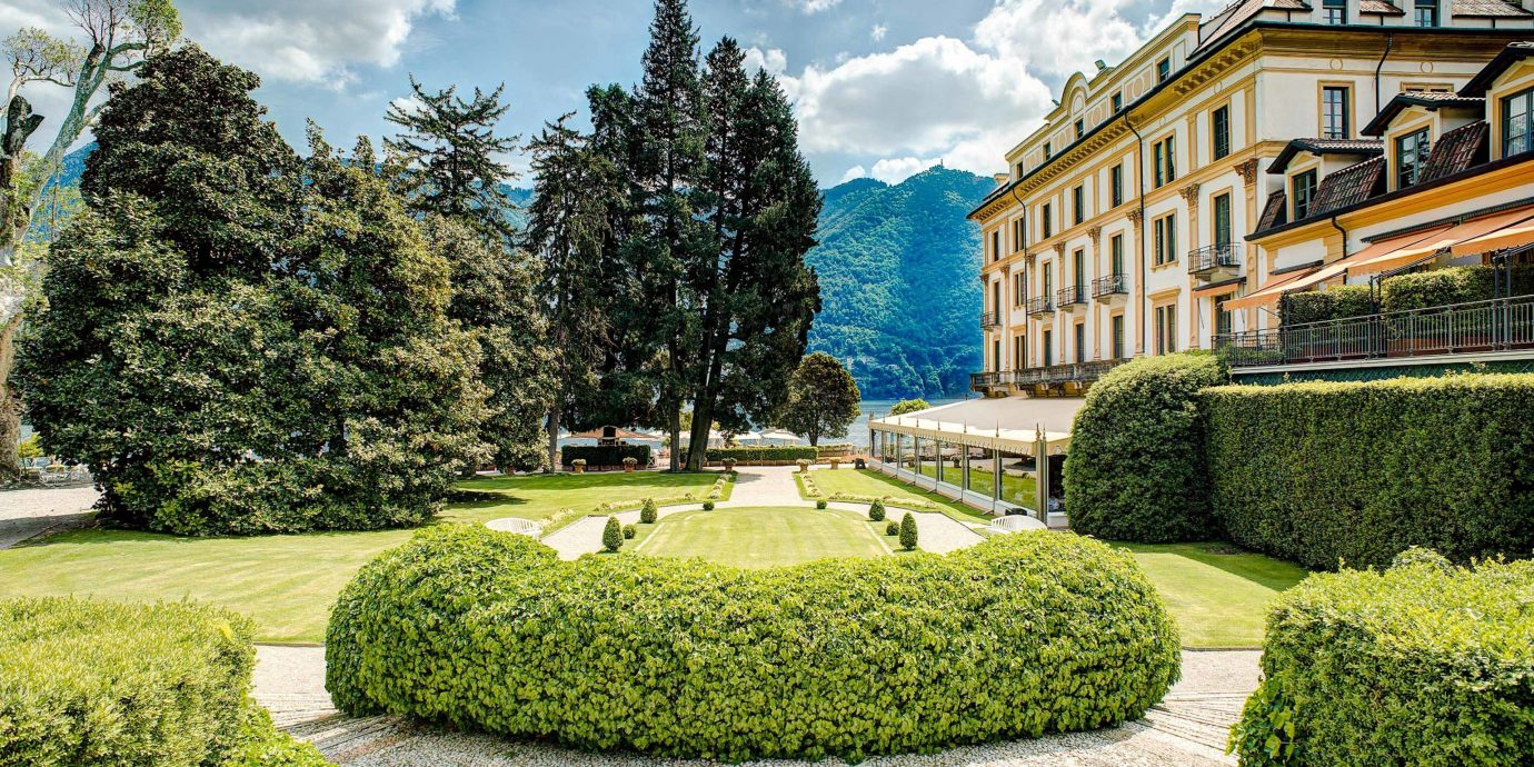 europe Hotels Trip Ideas estate property Garden grass real estate tree mansion national trust for places of historic interest or natural beauty lawn landscape botanical garden plantation Villa shrub landscaping stately home plant sky park facade house