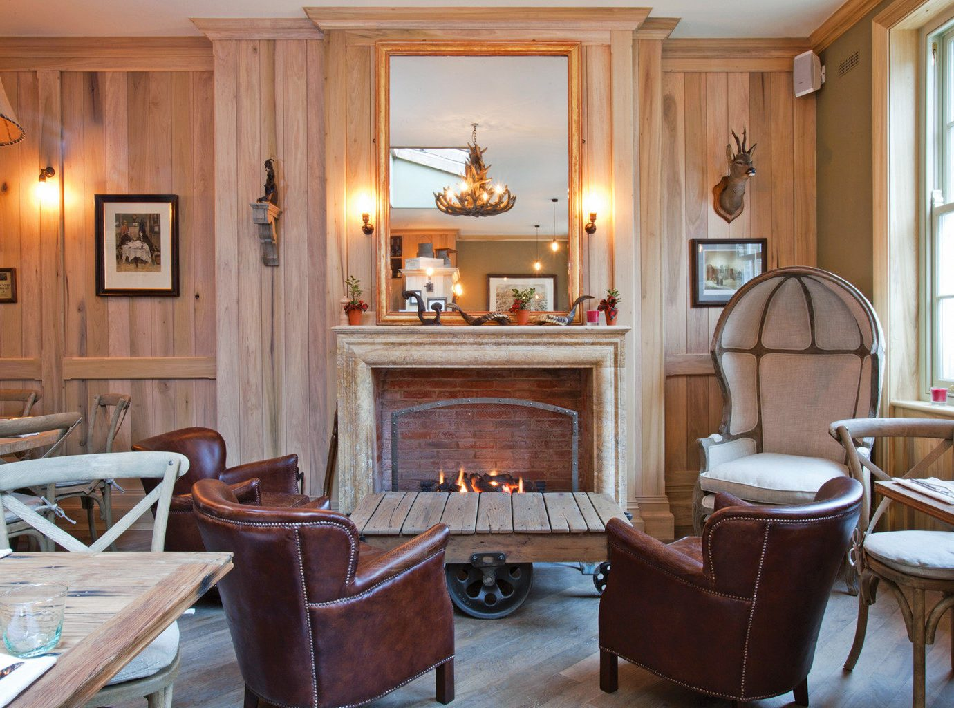 Boutique City Fireplace Lounge chair property living room home hardwood mansion cabinetry Suite cottage Lobby
