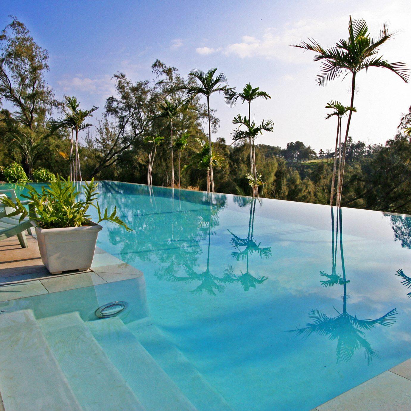 Boutique Eco Outdoors Pool tree sky swimming pool property leisure Resort Villa backyard condominium Deck day