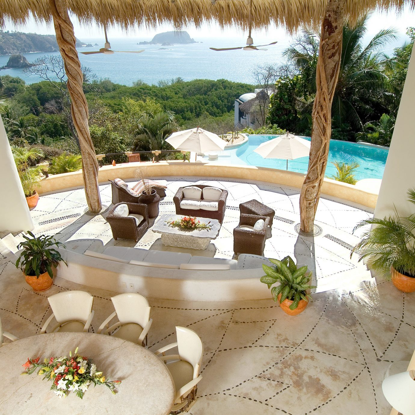 Boutique Lobby Pool Rustic Scenic views Waterfront tree property Villa backyard home Resort swimming pool hacienda mansion dining table