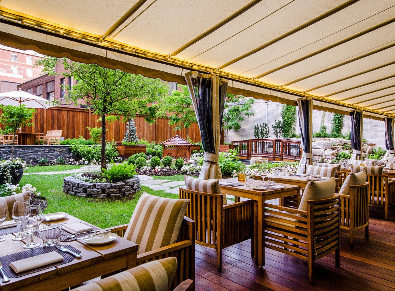 Canada Hotels Montreal Trip Ideas table chair building restaurant function hall real estate outdoor structure Dining interior design pergola backyard Patio set furniture