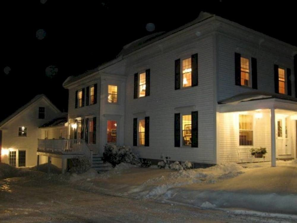 building house property home night snow residential area