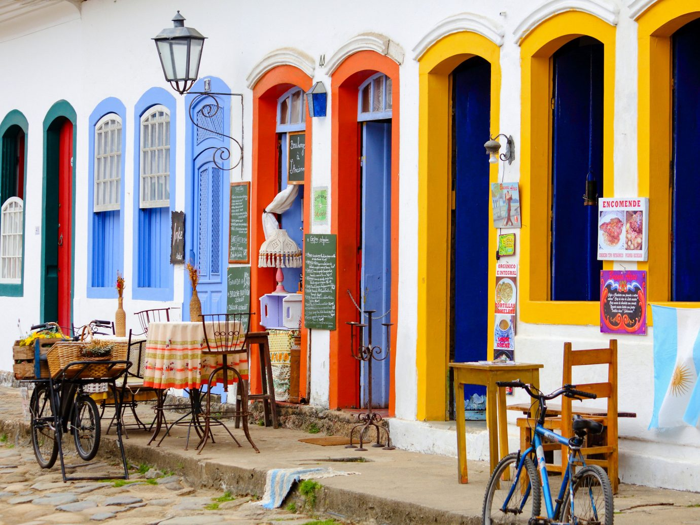Beaches Brazil Trip Ideas outdoor ground bicycle yellow window parked facade real estate street house recreation City cart