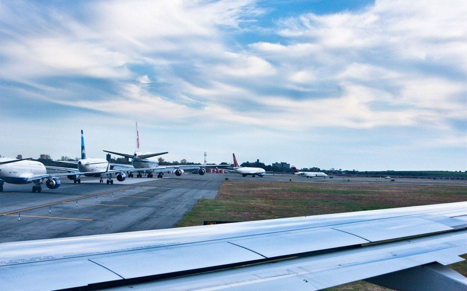 Offbeat sky outdoor plane airline runway airplane building aviation atmosphere of earth aircraft airport vehicle flight infrastructure airliner wing jet aircraft tarmac day