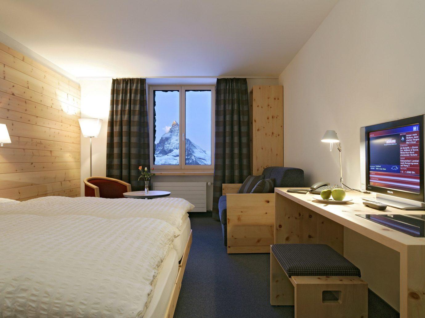 Hotels Offbeat indoor wall bed room floor Bedroom desk window ceiling Suite interior design real estate hotel dormitory