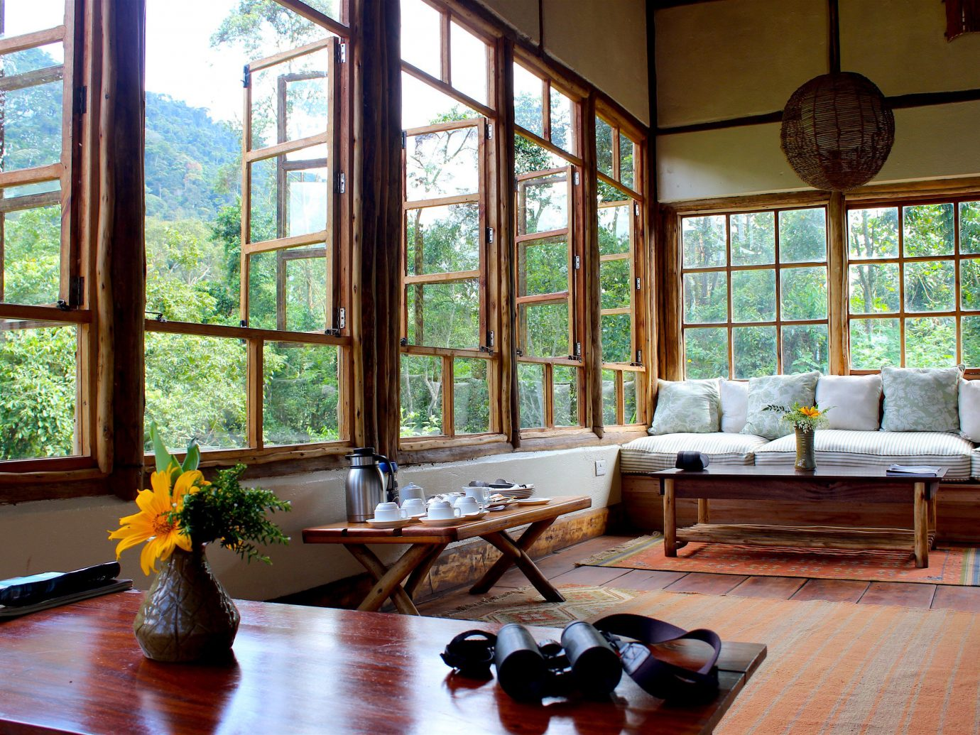 Adventure Hotels Off-the-beaten Path Outdoors + Adventure Trip Ideas window indoor Living room floor table living room interior design Fireplace home wood house real estate furniture flooring daylighting overlooking decorated