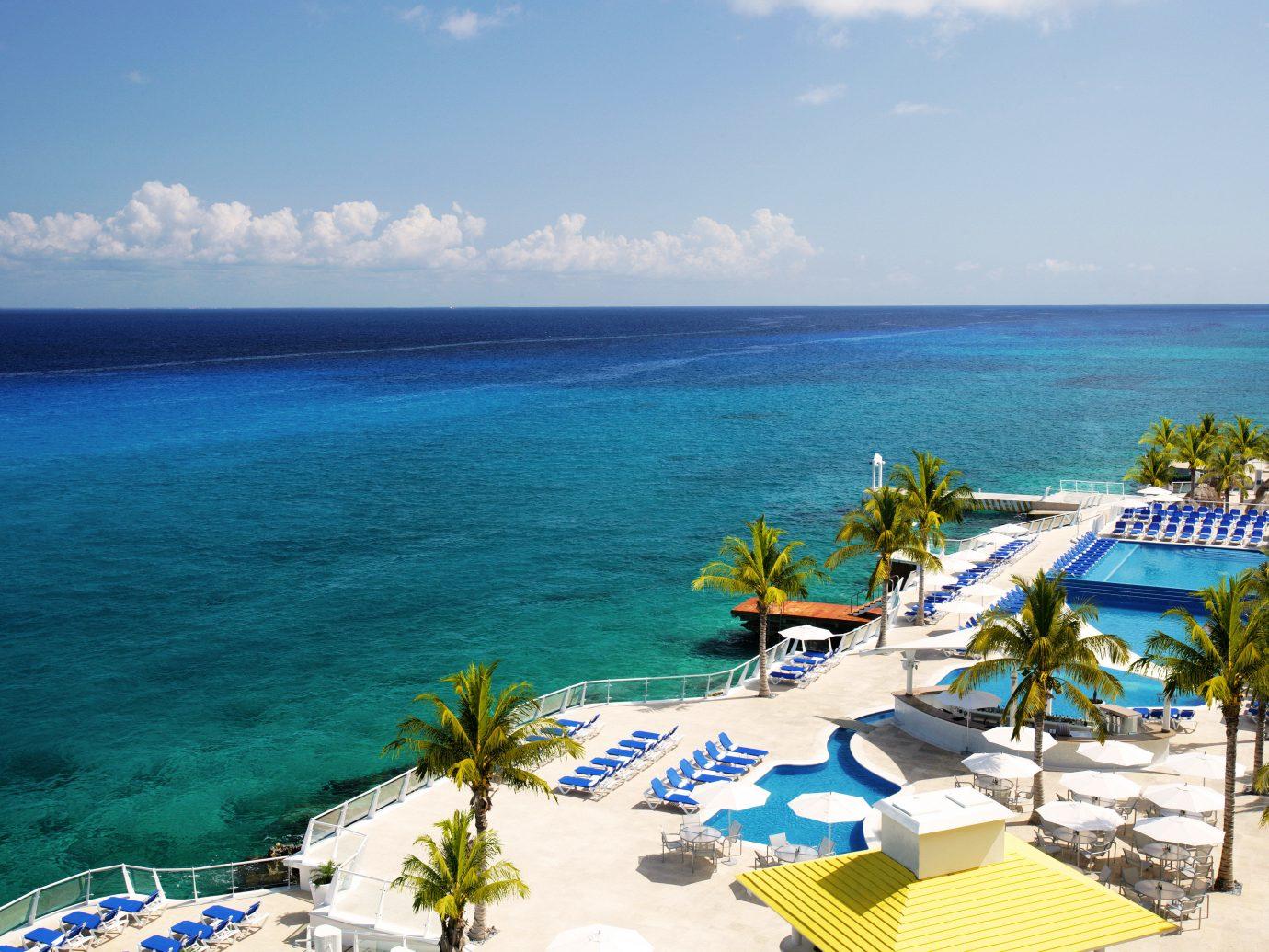 All-inclusive Beachfront Deck Hotels Lounge Luxury Pool Romance water sky umbrella outdoor Ocean Beach Sea leisure caribbean vacation Nature Coast Resort tourism cape bay shore Island islet Lagoon swimming day sandy