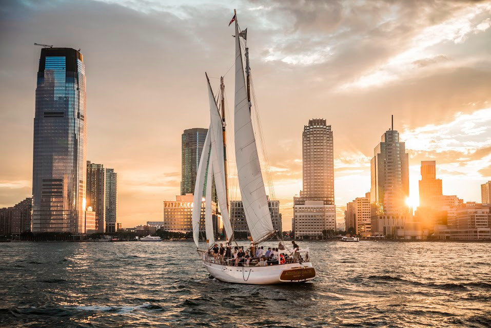Gift Guides water outdoor sky cityscape skyscraper skyline City metropolis urban area daytime building Sunset tower block sail background reflection evening metropolitan area dusk ship Harbor water transportation Downtown Boat Sea sailing ship tower calm sailing vessel day