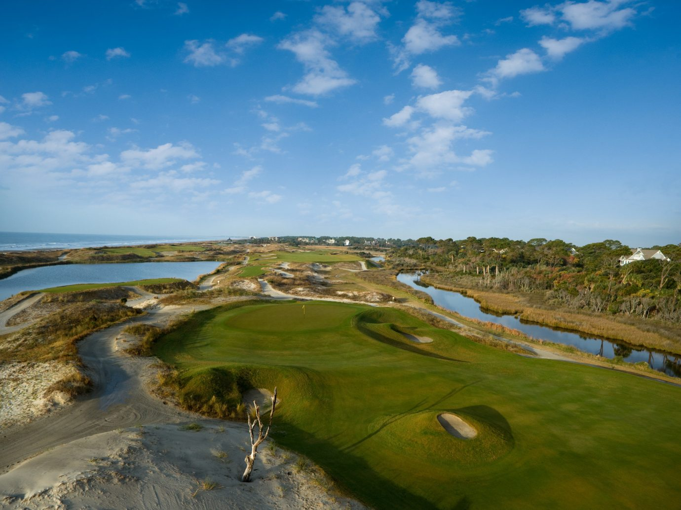 Beach East Coast USA Trip Ideas sky outdoor structure Nature aerial photography sport venue grass Sea atmosphere of earth cloud golf course hill Coast landscape rural area reflection sports day land highland