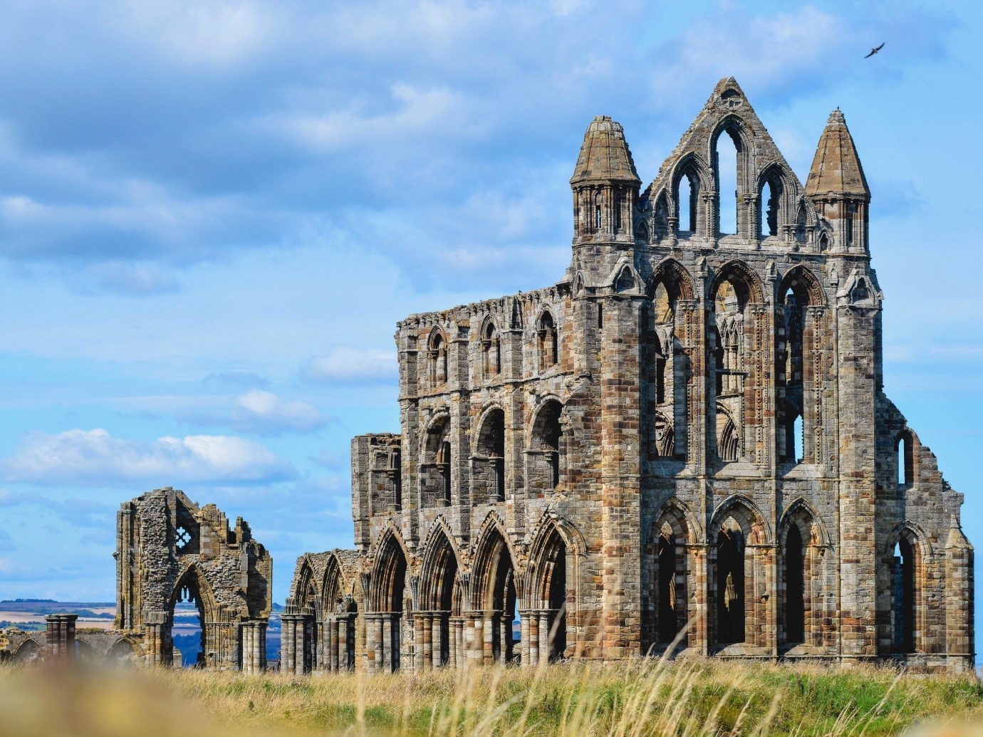 Romance Trip Ideas Weekend Getaways sky outdoor building historic site medieval architecture Church stone old cathedral place of worship Ruins abbey stately home big château steeple facade ancient history tall middle ages history tours spire listed building day