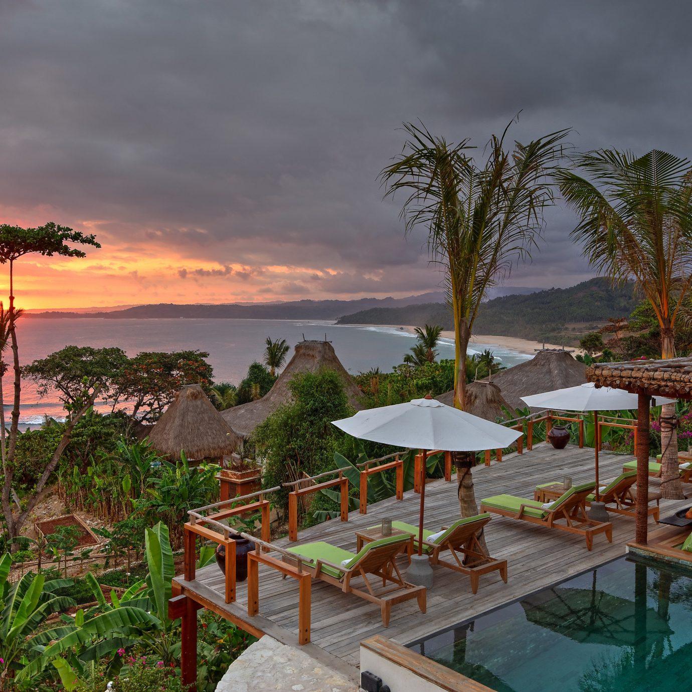 Islands Luxury Travel Trip Ideas sky tree outdoor Resort vacation Ocean arecales tropics Sea estate caribbean Beach Coast bay set colorful several