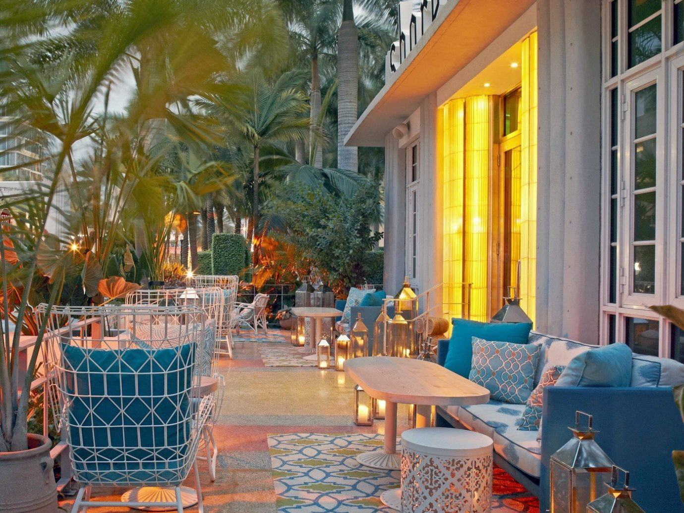 ambient lighting building candlelight Exterior fancy Hip hotel lanterns lights night lights outdoor lounge palm trees Patio sophisticated tables Terrace Travel Tips trendy Trip Ideas Tropical Weekend Getaways tree outdoor leisure property Resort estate vacation swimming pool backyard home restaurant mansion Villa furniture