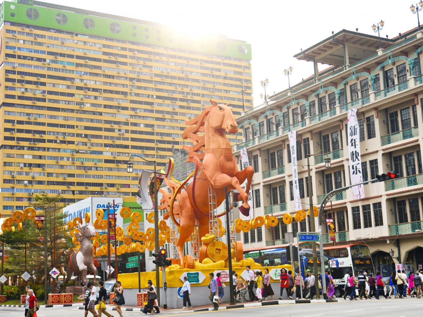 Offbeat Singapore Trip Ideas building outdoor plaza art advertising crowd