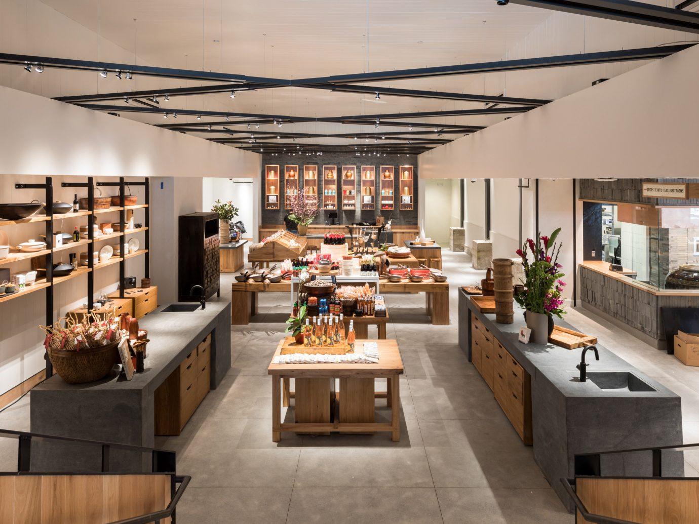 Hotels Trip Ideas indoor table ceiling floor interior design exhibition counter Bar furniture Island