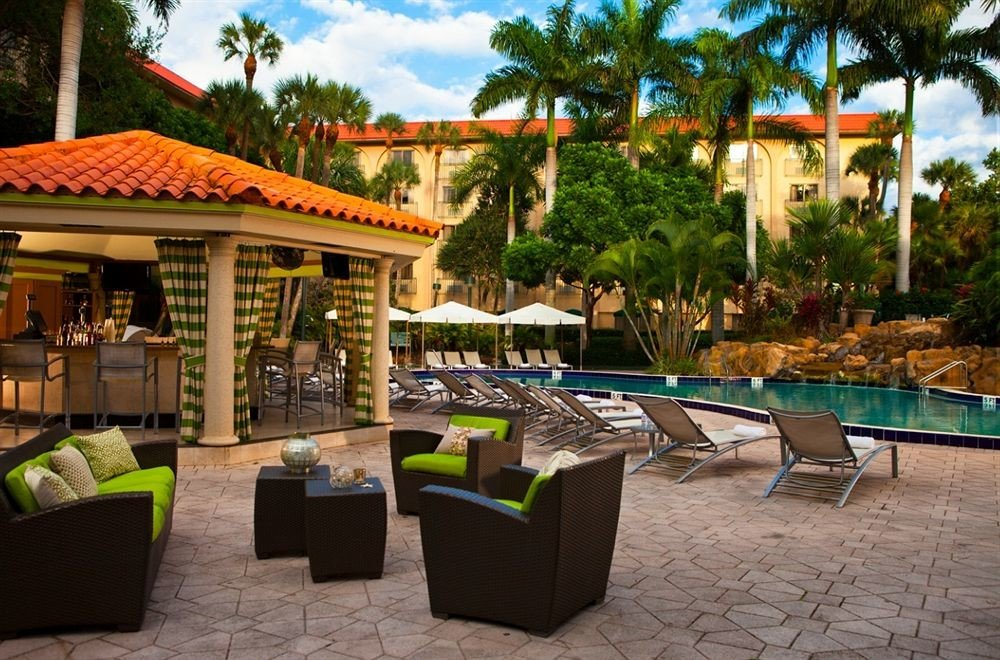 Classic Pool tree ground leisure property Resort green Villa hacienda outdoor structure backyard Courtyard
