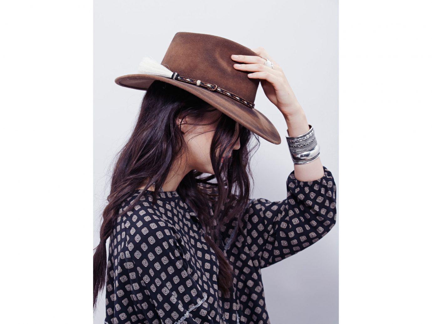 Style + Design person clothing woman hat cap pattern fashion accessory Design polka dot outerwear neck headgear fedora