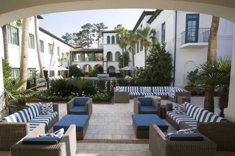 Lounge Luxury building chair property condominium home living room house Villa mansion Courtyard porch outdoor structure backyard cottage Deck Modern set stone