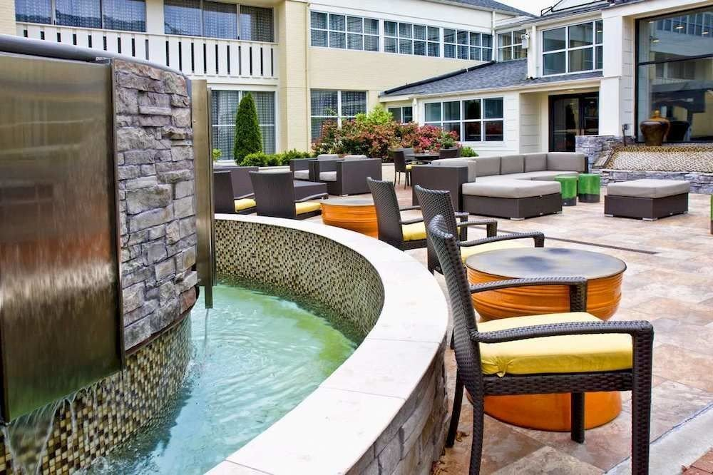building property condominium swimming pool backyard Courtyard home outdoor structure Villa Patio Deck yard cottage