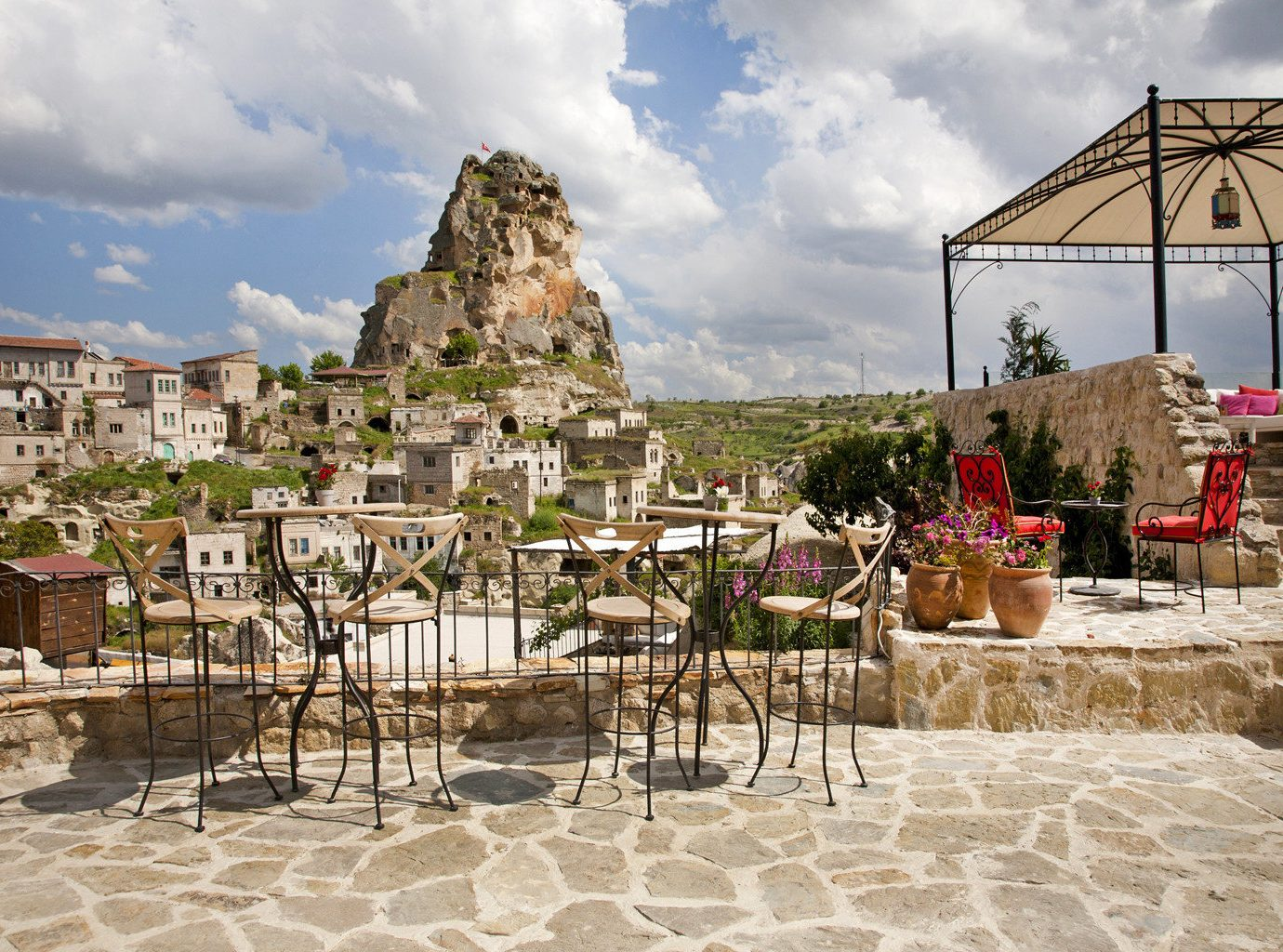 Courtyard Dining Drink Eat Lounge Patio Rustic Terrace sky Town ancient history Village Resort palace temple hindu temple travel flower