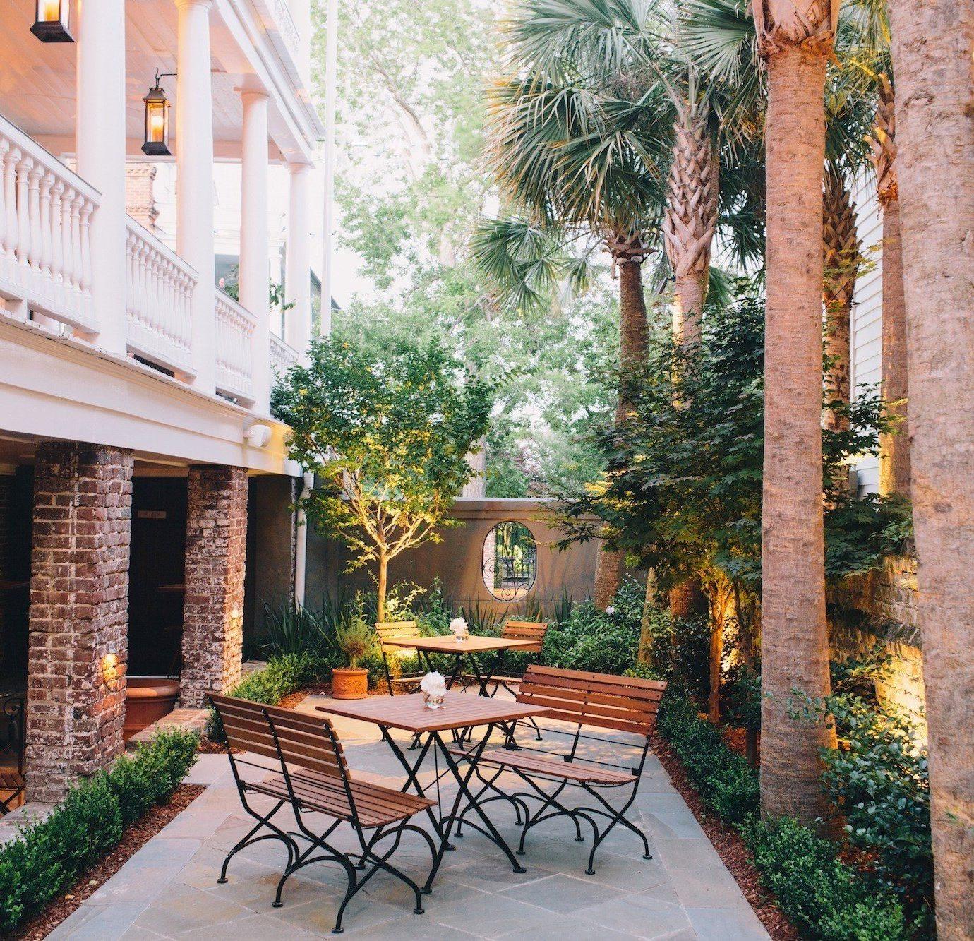 property Courtyard house backyard home park brick Villa porch cottage yard outdoor structure Garden hacienda Resort stone mansion