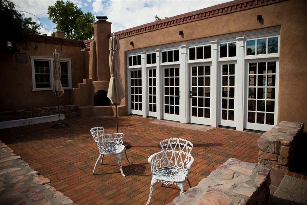 chair property house home Courtyard outdoor structure mansion porch cottage backyard Villa hacienda brick stone