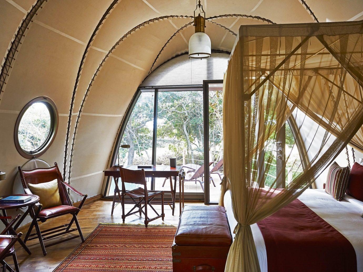 Hotels Outdoors + Adventure chair indoor room interior design estate home real estate window furniture
