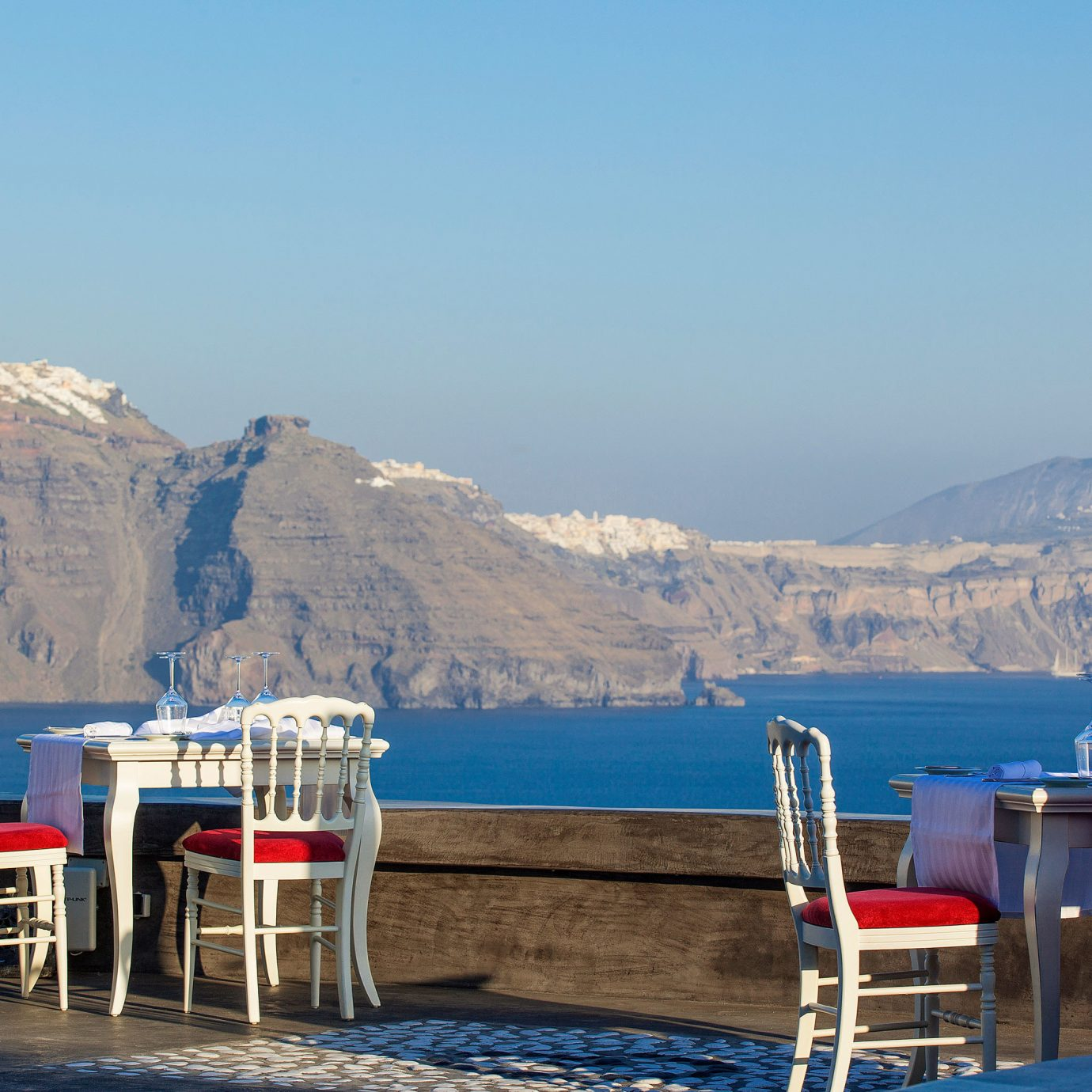 Cultural Deck Dining Drink Eat Elegant Honeymoon Island Outdoors Romance Romantic Scenic views Waterfront sky mountain chair Sea Nature vehicle Resort shore