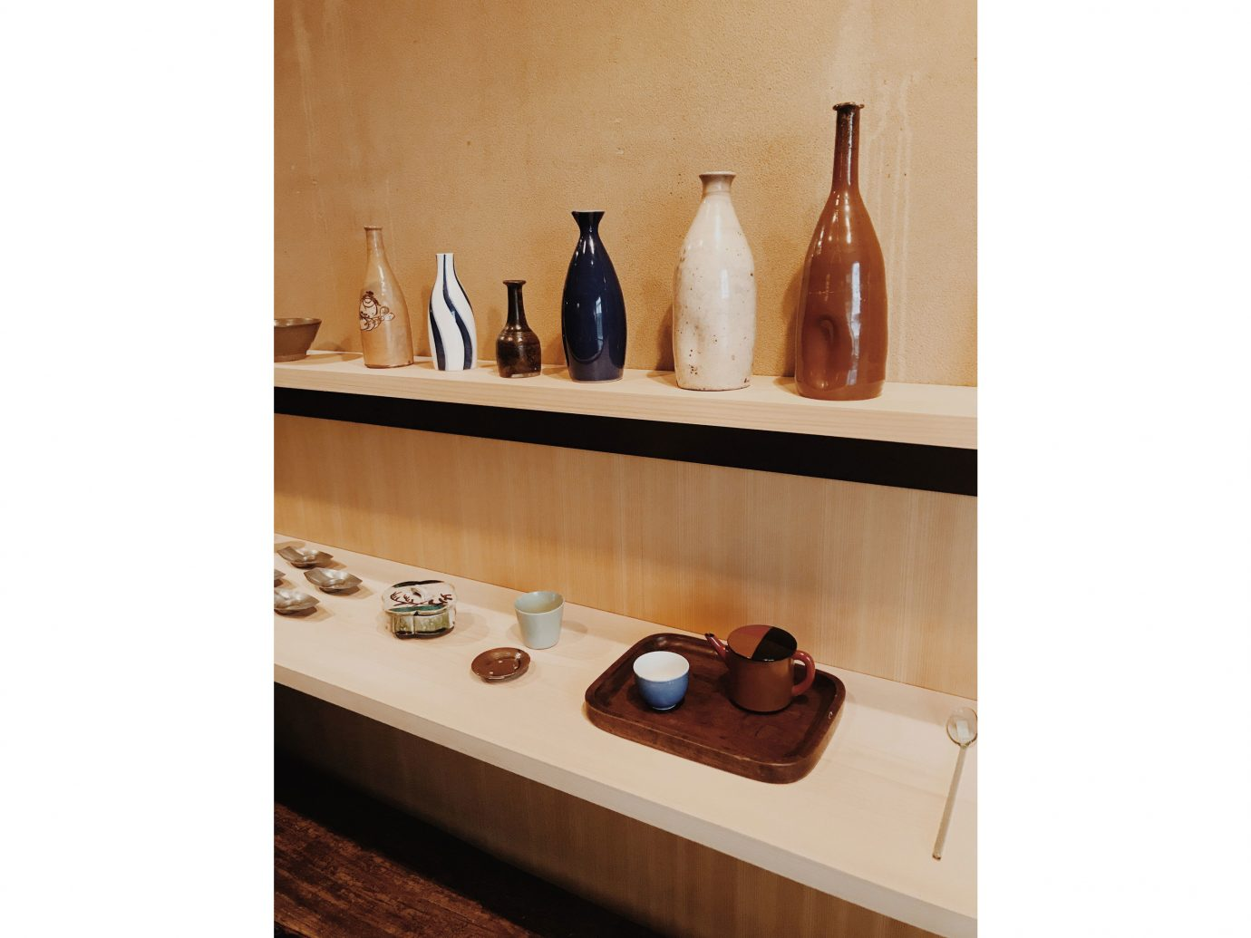 Influencers + Tastemakers Japan Photo Diary Tokyo indoor furniture shelf product design wood table different ceramic several