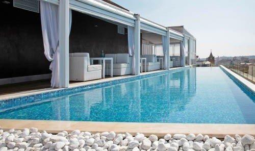 Food + Drink swimming pool outdoor property Villa blue Resort real estate condominium estate Pool