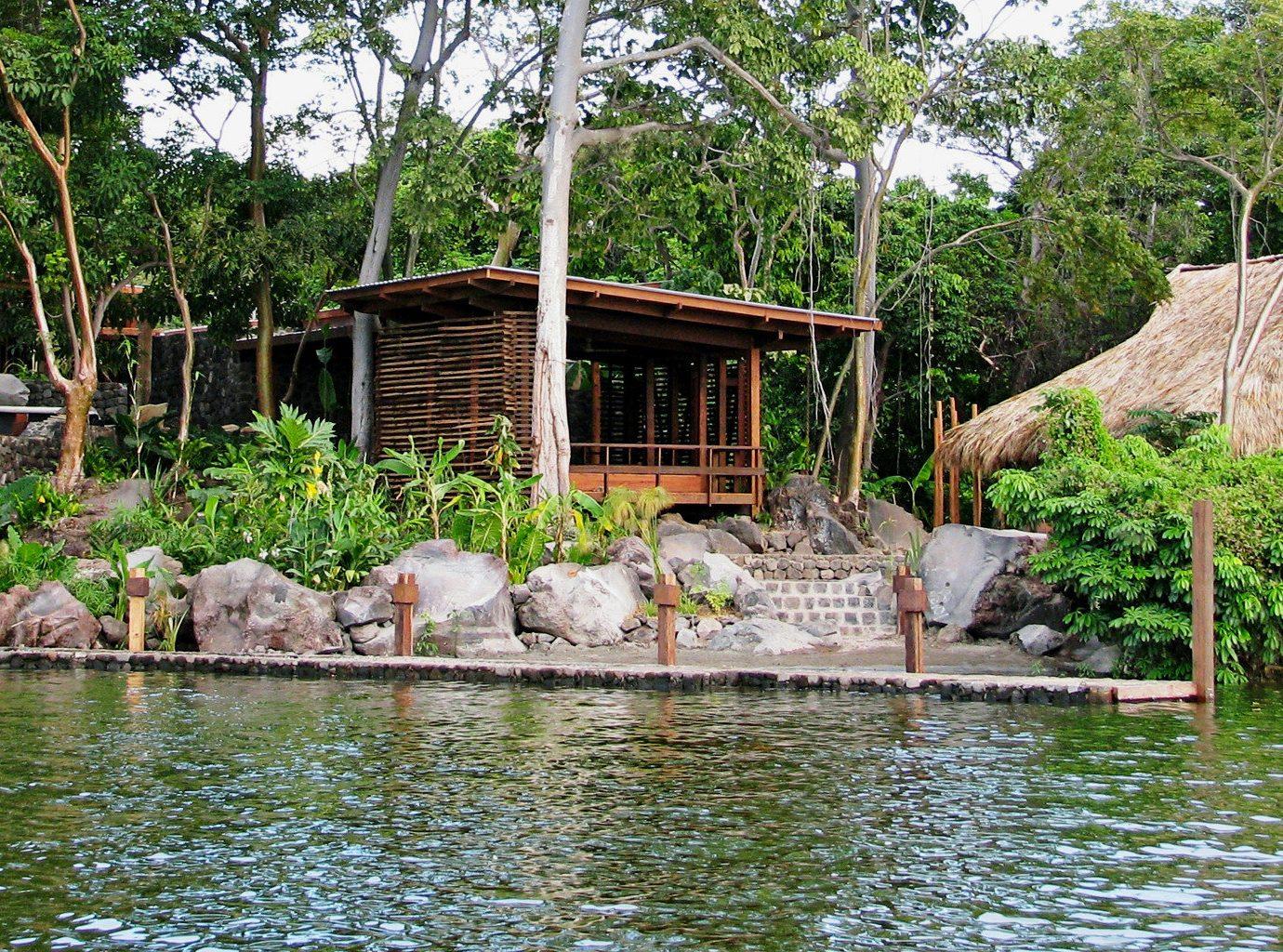 All-inclusive Beach Eco Resort Romantic Secret Getaways Trip Ideas Wellness tree outdoor Nature pond Jungle zoo Garden backyard swimming pool Village stone several