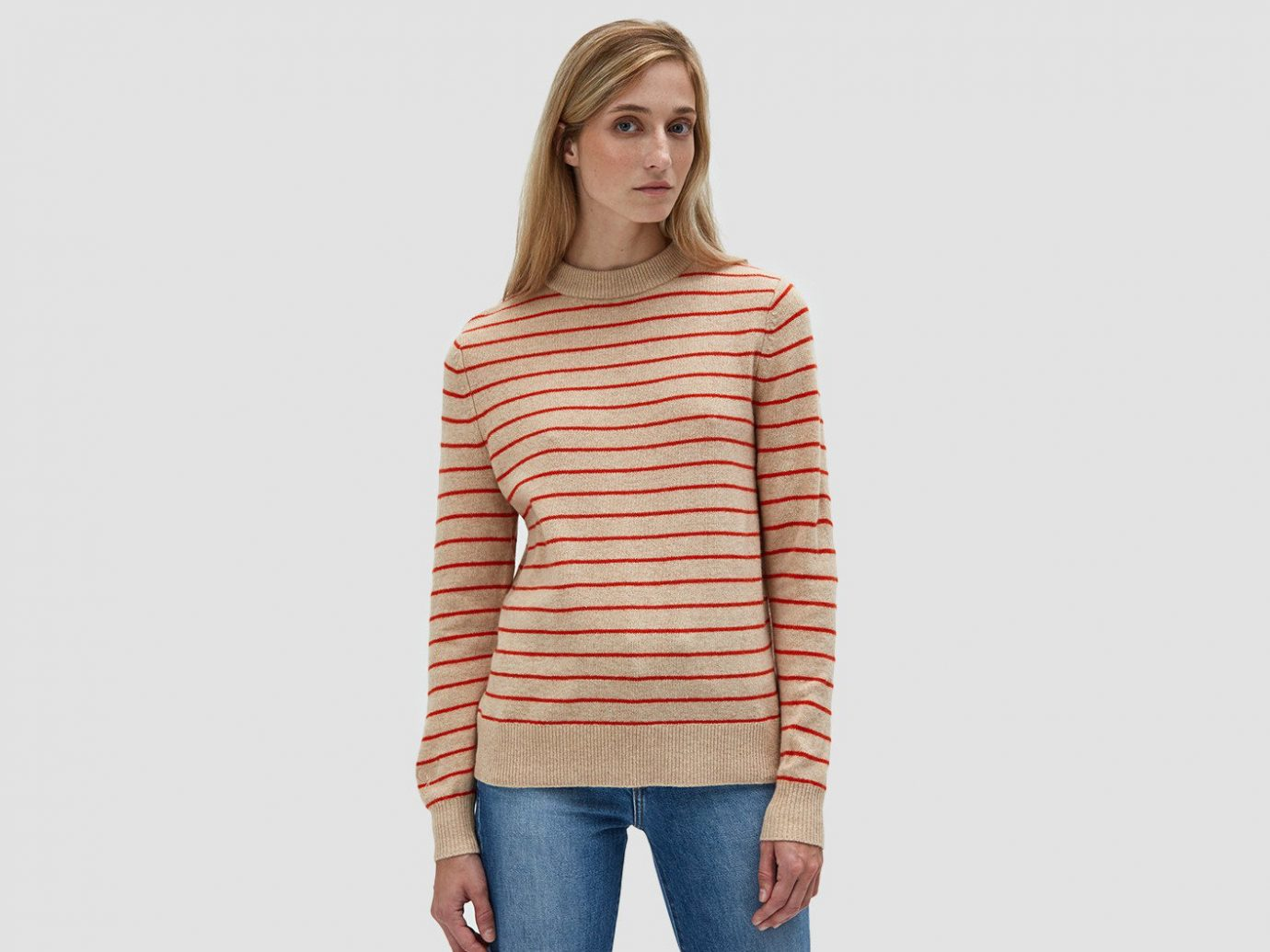 Fall Travel Style + Design Travel Shop Weekend Getaways person clothing sleeve shoulder sweater neck joint standing long sleeved t shirt posing peach woolen trouser