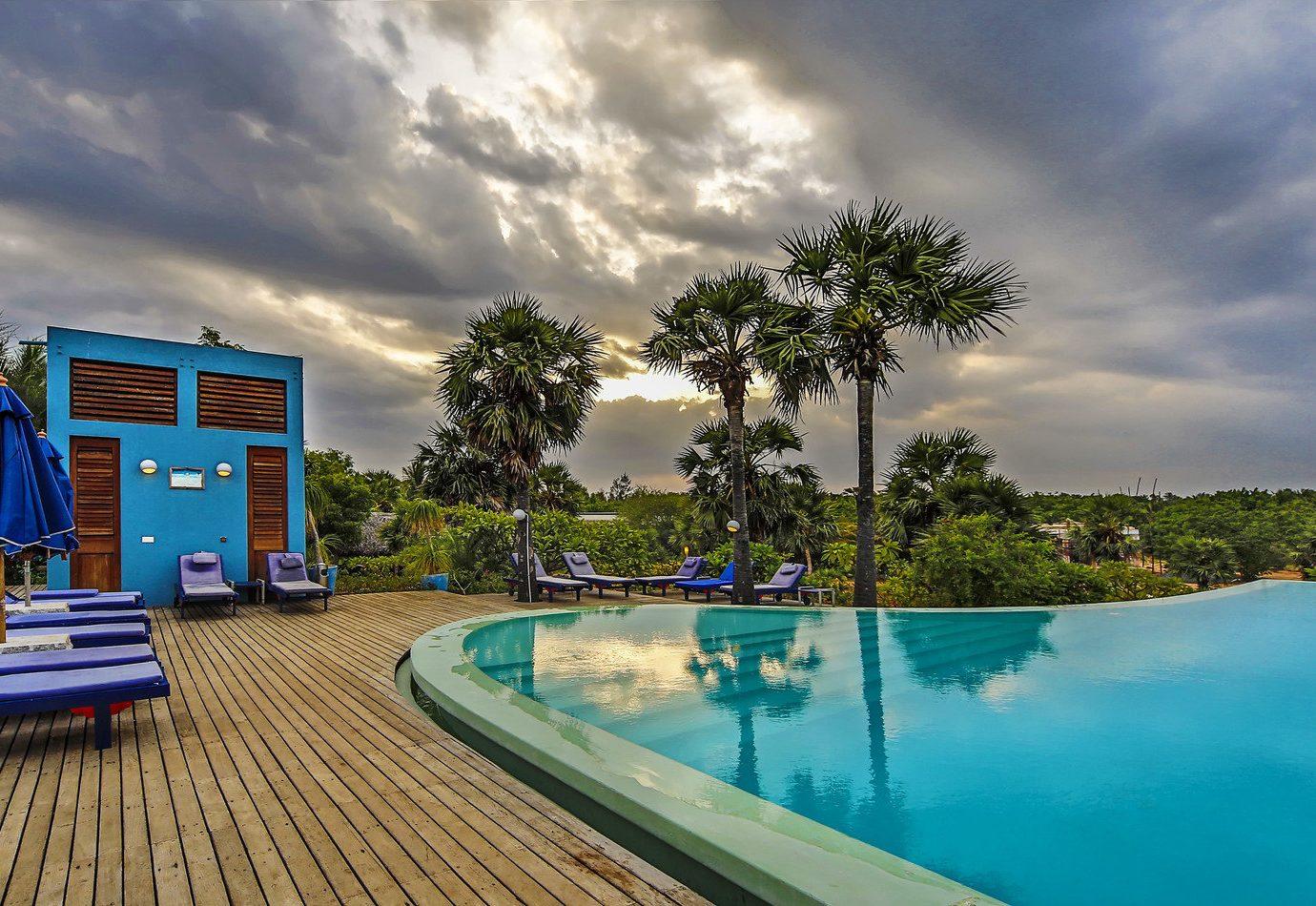 Hotels sky outdoor Beach swimming pool leisure property blue Resort estate vacation home real estate condominium Pool Villa backyard colorful Deck Boat shore