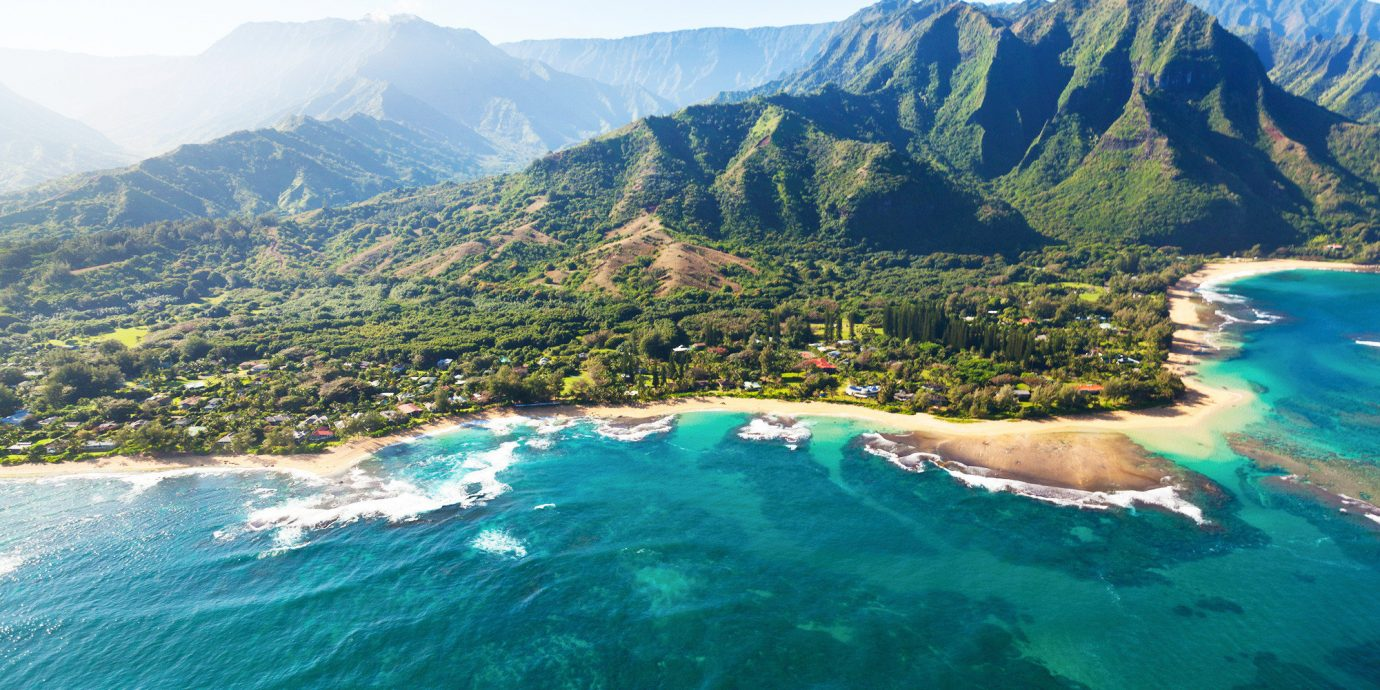 Beach Jetsetter Guides Mountains Nature Outdoors Scenic views mountain outdoor sky water geographical feature landform body of water Sea Coast background Ocean mountain range cape bay fjord terrain Lake cliff surrounded distance highland