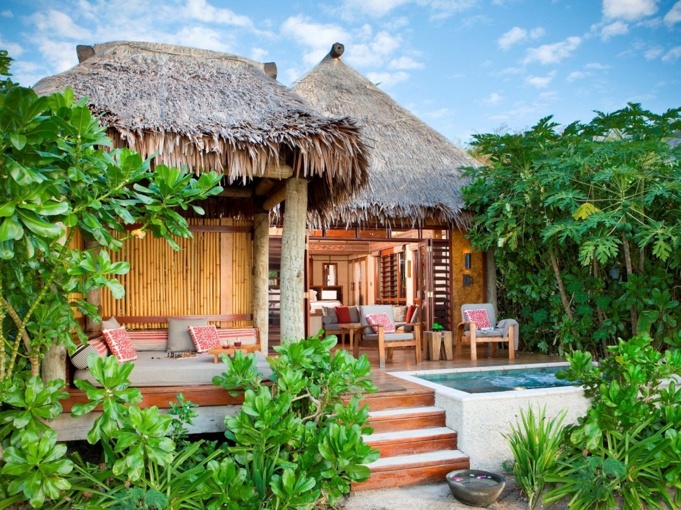 All-Inclusive Resorts Hotels Luxury Travel outdoor tree property Resort hut cottage real estate thatching hacienda eco hotel plant home estate outdoor structure Jungle arecales house Villa Garden leisure roof bushes area stone surrounded