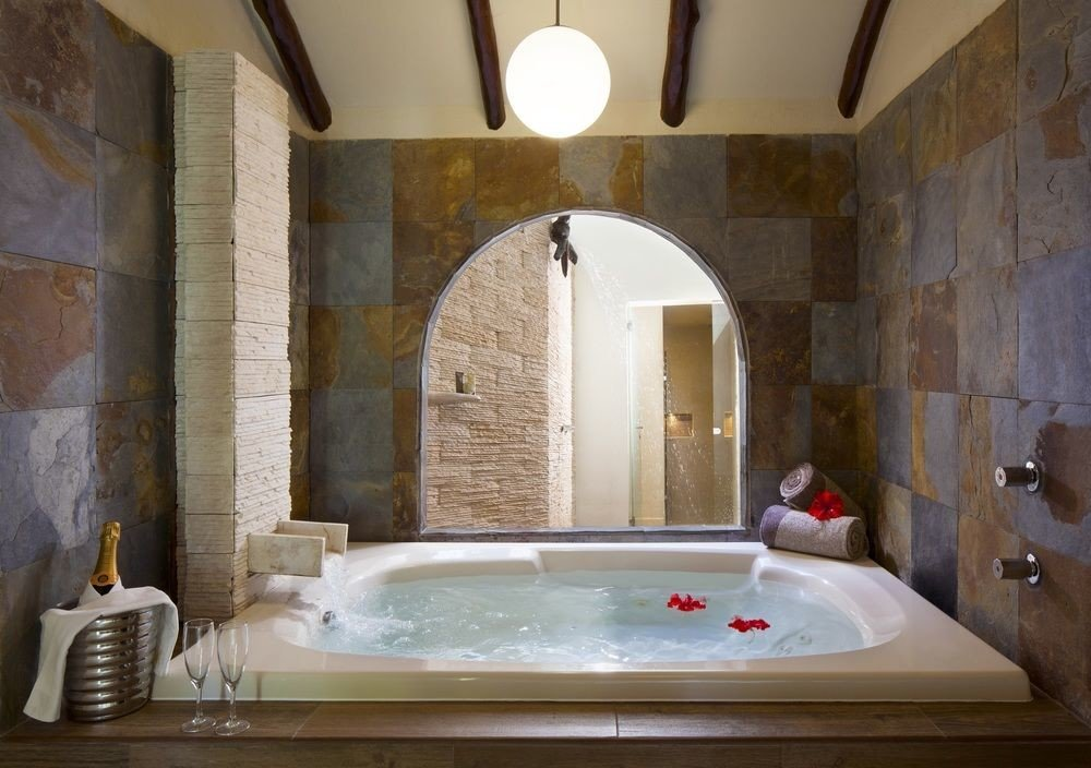 All-Inclusive Resorts Hotels bathroom wall indoor sink vessel room property estate bathtub interior design Suite tub ceiling jacuzzi angle amenity Bath stone