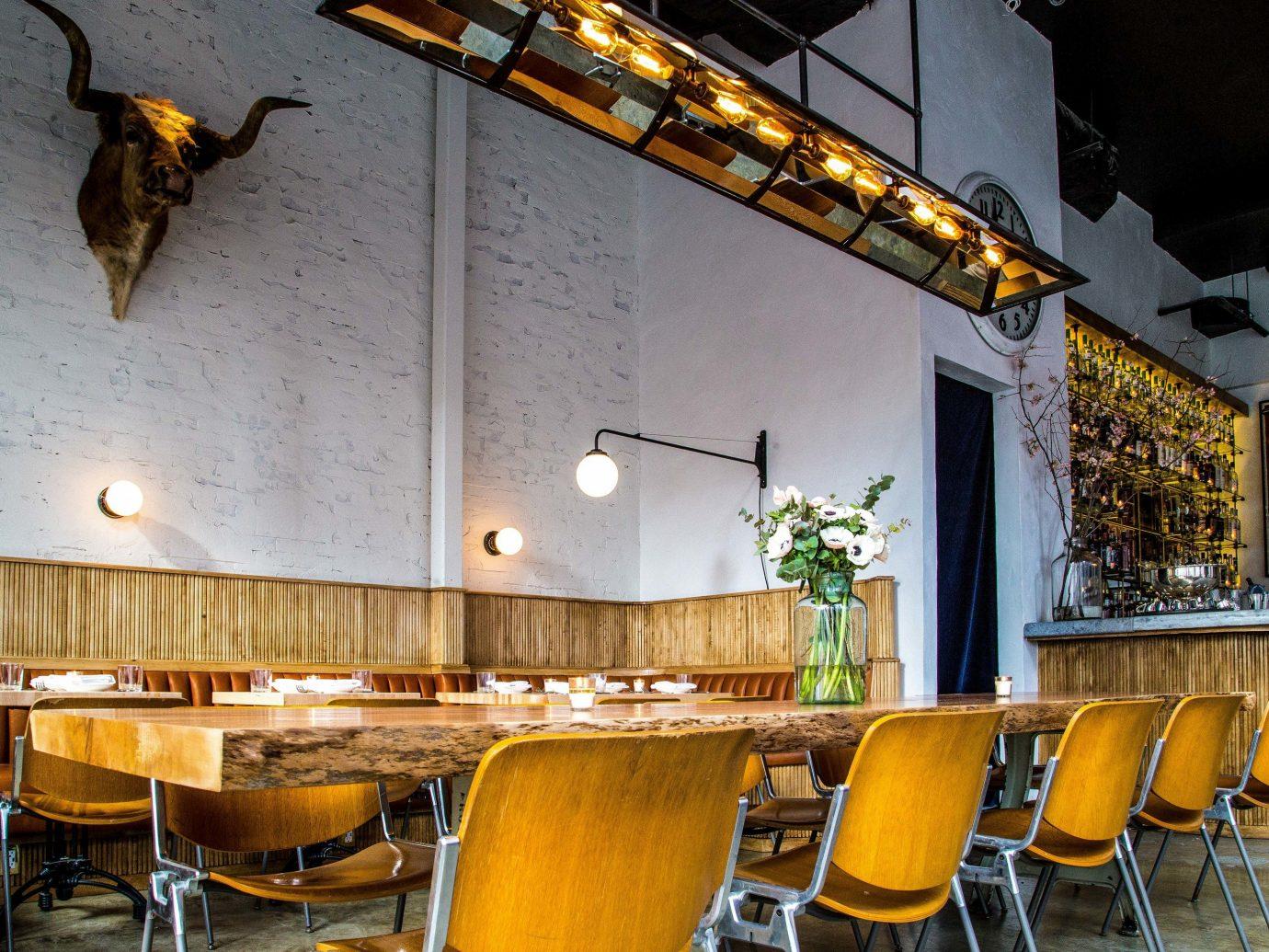 Trip Ideas Weekend Getaways table indoor chair restaurant Bar Dining yellow interior design meal area