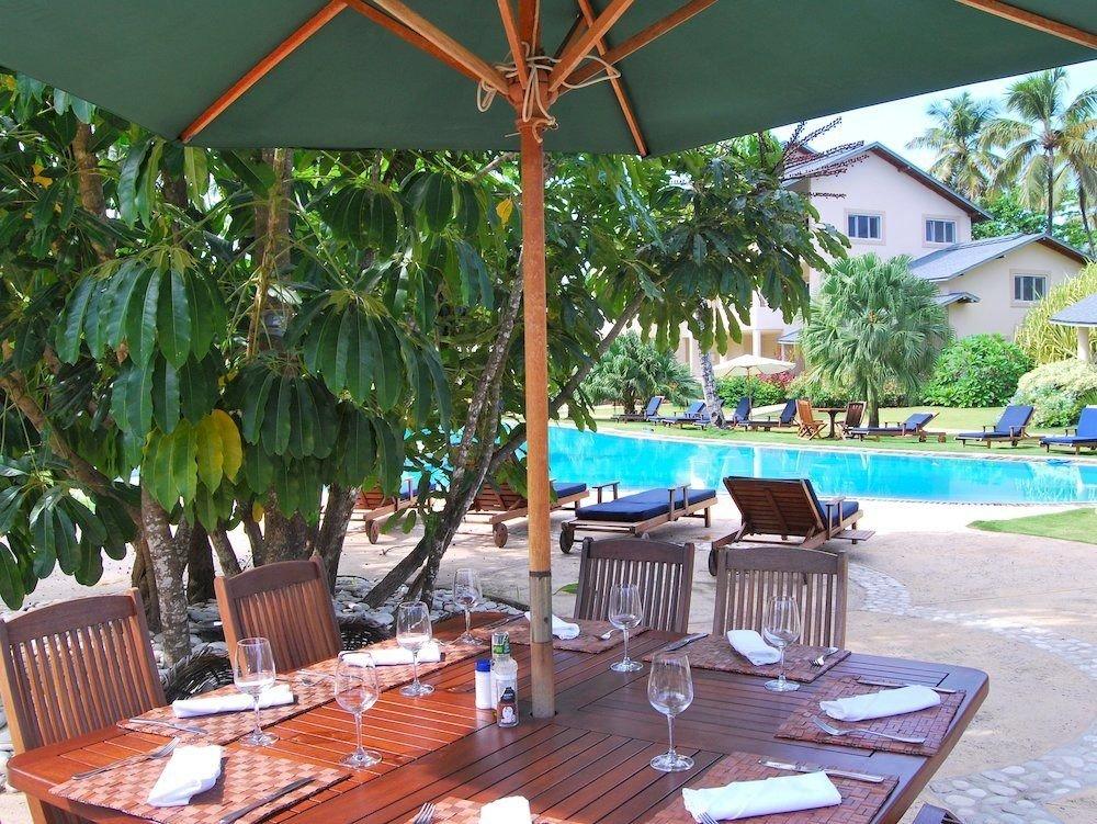 Exterior Lounge Pool tree umbrella chair property Dining Resort restaurant Villa backyard eco hotel hacienda swimming pool cottage caribbean set shade Deck