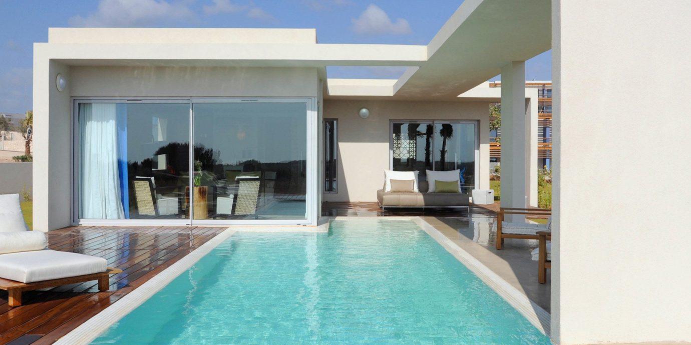 Golf Modern Patio Pool Spa swimming pool property wooden building leisure centre Villa condominium Resort home Deck