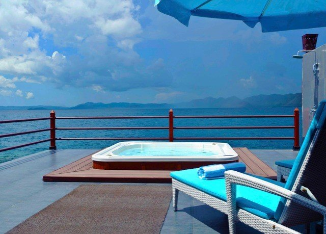sky swimming pool chair leisure caribbean vehicle passenger ship Deck Sea yacht Lagoon blue overlooking