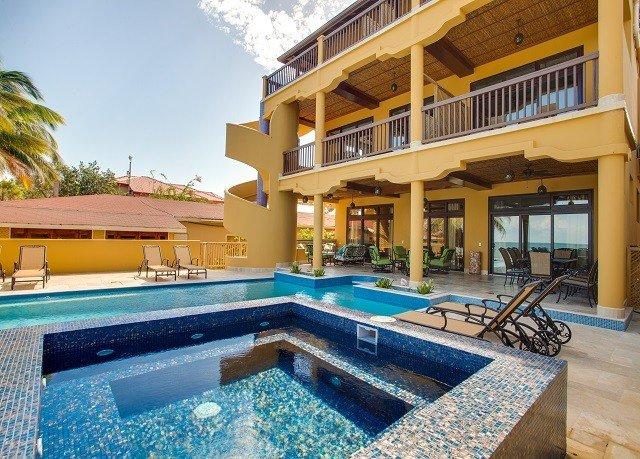 building swimming pool property condominium Villa Resort leisure home mansion backyard blue Deck
