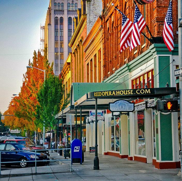 Offbeat outdoor urban area neighbourhood City Town Downtown street mixed use metropolitan area building metropolis road facade tree pedestrian several