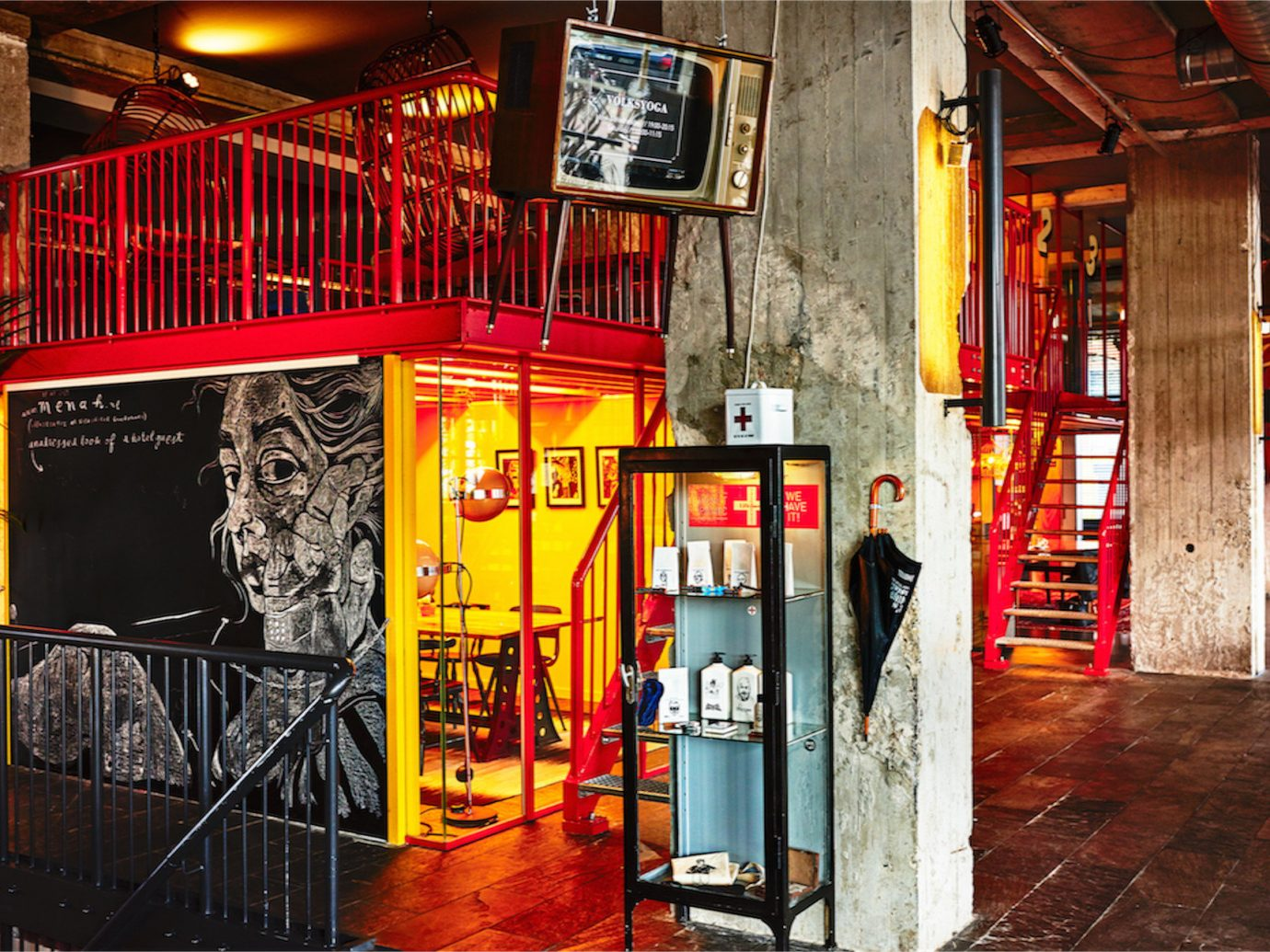 ambient lighting artistic artsy colorful foyer Hip Hotels industrial lights Lobby space staircase trendy urban building color road urban area street art alley