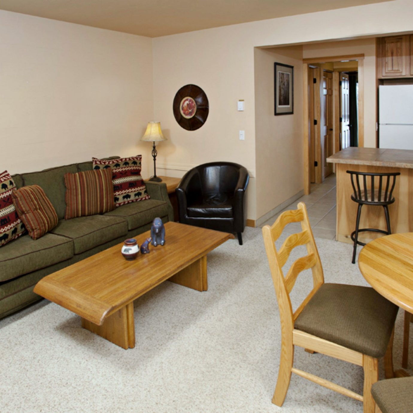 Dining Lounge Resort chair property living room home hardwood cottage wooden Suite recreation room leather dining table