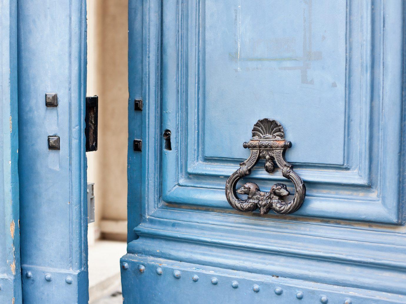 Offbeat color blue outdoor white building house wall window wood door