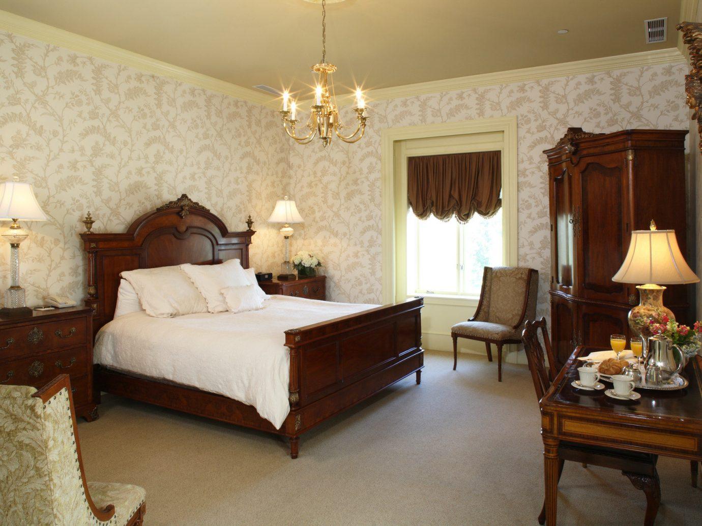 Hotels indoor floor wall room property Bedroom bed estate Suite cottage home living room interior design Villa real estate mansion farmhouse furniture area
