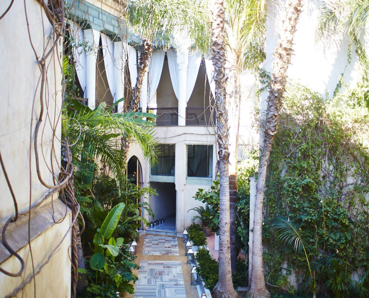 Arts + Culture Marrakech Morocco Style + Design tree property house estate home Resort vacation Courtyard mansion Villa real estate hacienda backyard Garden plant